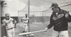 Jim French watching Ted Williams give batting instructions during spring training, 1969, at Pompano Beach, Florida.