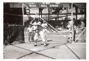Jackie Jensen, Red Sox Right Fielder in Batting Cage, Bob Farmer & Denny MacDougal looking on.